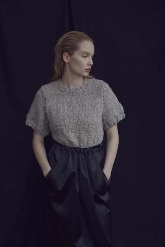 knitted t-shirt / black skirt